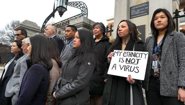 Members of the Asian American Commission condemning racism toward the Asian American community because of coronavirus, outside the Massachusetts State House in Boston in March.